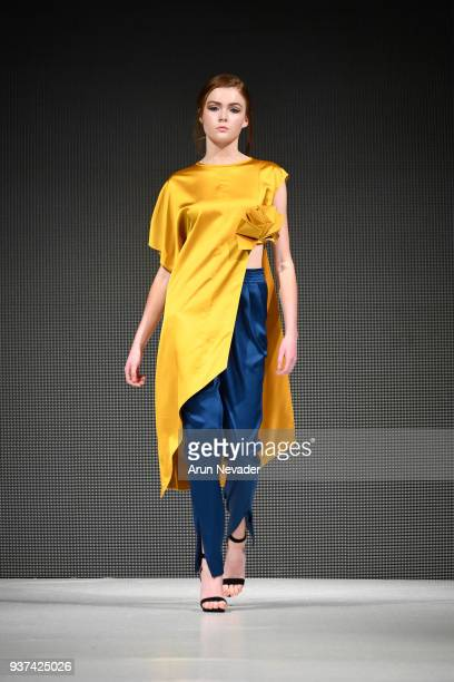 Model walks the runway wearing Minestilo at 2018 Vancouver Fashion Week - Day 4 on March 22, 2018 in Vancouver, Canada.