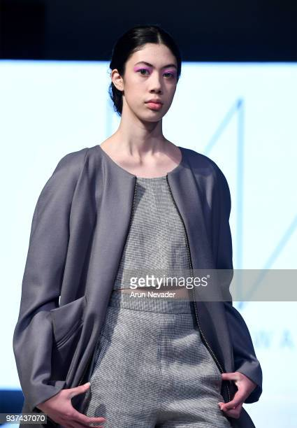 A model walks the runway wearing Miranda Watson at 2018 Vancouver Fashion Week Day 4 on March 22 2018 in Vancouver Canada