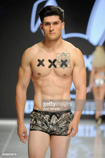 A model walks the runway wearing Mister Triple x at Los Angeles Fashion Week SS18 Art Hearts Fashion LAFW on October 7 2017 in Los Angeles California