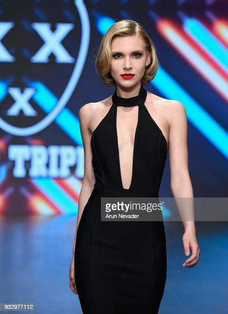 Model walks the runway wearing Mister Triple X at Los Angeles Fashion Week Powered by Art Hearts Fashion LAFW FW/18 10th Season Anniversary at The...