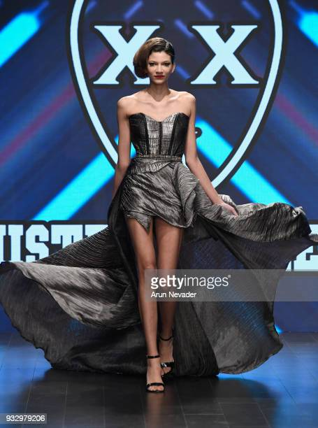 A model walks the runway wearing Mister Triple X at Los Angeles Fashion Week Powered by Art Hearts Fashion LAFW FW/18 10th Season Anniversary at The...
