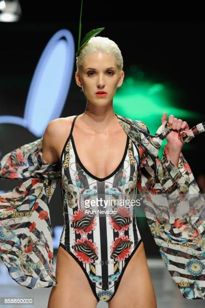 A model walks the runway wearing Mister Triple x Tropix Resort at Los Angeles Fashion Week SS18 Art Hearts Fashion LAFW on October 7 2017 in Los...