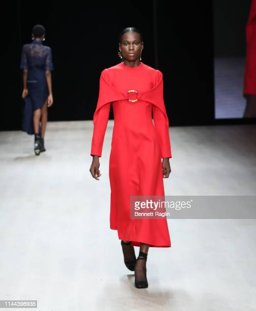Model walks the runway wearing MmusoMaxellL during Arise Fashion Week on April 21, 2019 in Lagos, Nigeria.