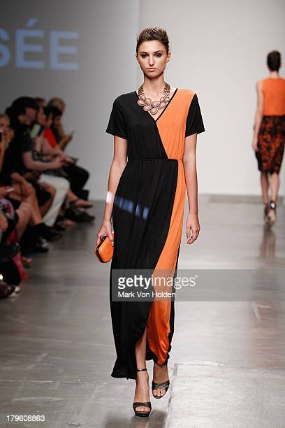A model walks the runway wearing Mossee in the Fashion Palette Australia fashion show during MercedesBenz Fashion Week Spring 2014 at Pier 59 on...