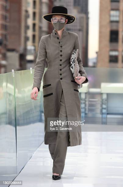 Model walks the runway wearing NAA-ADEI LAURA MARMON with CARRIAZO Jewelry, MICHELLE LOOK bags and Nichol Isadora Kelly sunglasses during the Flying...