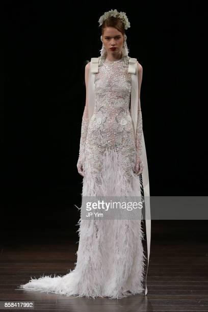 A model walks the runway wearing Naeem Khan Bridal Fall 2018 on October 6 2017 in New York City