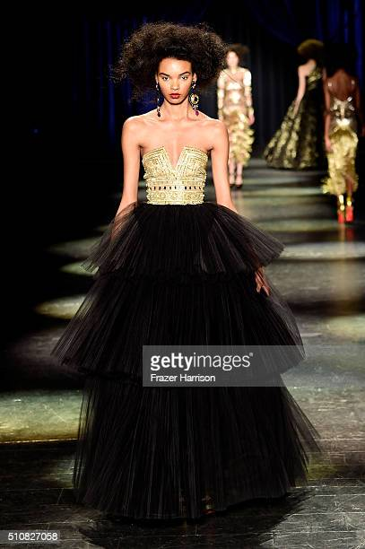 A model walks the runway wearing Naeem Khan Fall 2016 during New York Fashion Week The Shows at The Arc Skylight at Moynihan Station on February 17...