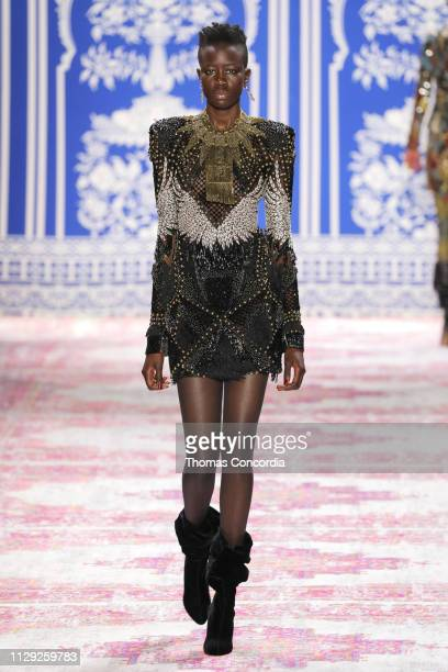 A model walks the runway wearing Naeem Khan Fall 2019 with hair by TRESemme´and makeup by Maybelline New York at Gallery I at Spring Studios on...