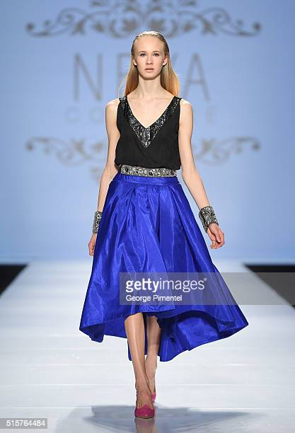 A model walks the runway wearing Neya Couture 2016 collection during Toronto Fashion Week Fall 2016 at David Pecaut Square on March 15 2016 in...