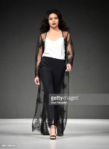 A model walks the runway wearing Noelle Lemieux at 2018 Vancouver Fashion Week Day 4 on March 22 2018 in Vancouver Canada