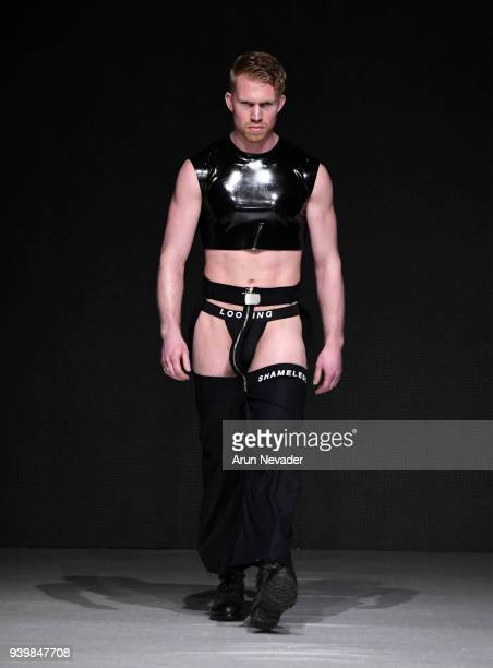 A model walks the runway wearing Not Dead Yet at 2018 Vancouver Fashion Week Day 7 on March 25 2018 in Vancouver Canada
