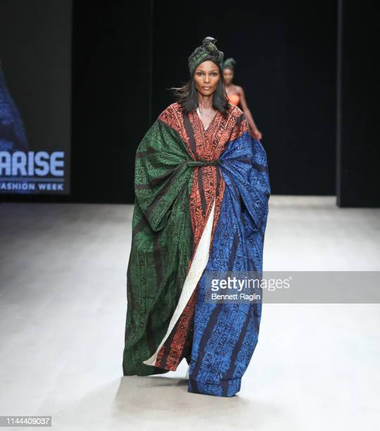 Model walks the runway wearing Odio Mimonet during Arise Fashion Week on April 21, 2019 in Lagos, Nigeria.