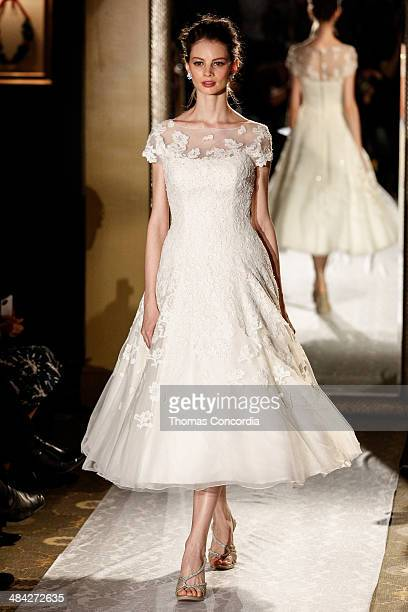 A model walks the runway wearing Oleg Cassini Spring 2015 Bridal collection at the Plaza Athenee on April 11 2014 in New York City