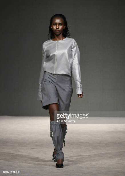 A model walks the runway wearing ORCHIDELIRIUM at Vancouver Fashion Week Spring/Summer 19 Day 4 on September 20 2018 in Vancouver Canada