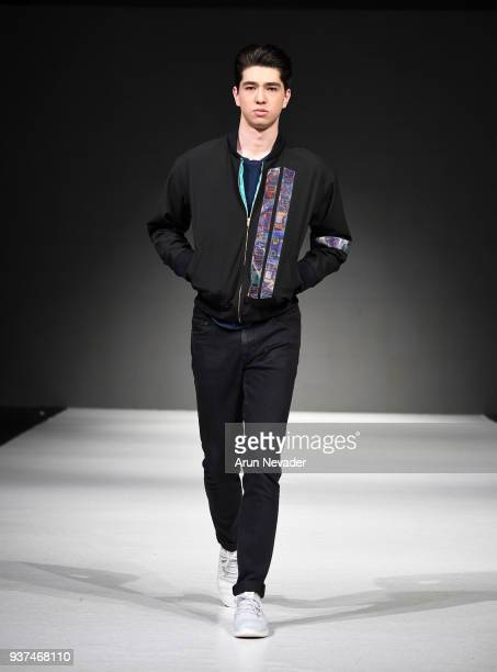A model walks the runway wearing Pariah at 2018 Vancouver Fashion Week Day 4 on March 22 2018 in Vancouver Canada