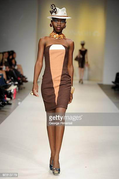 A model walks the runway wearing Pat McDonagh's 2010 Spring Collection at 1030 King St W on October 23 2009 in Toronto Canada