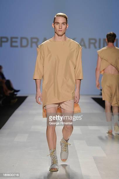 A model walks the runway wearing Pedram Karimi spring 2014 collection during the MercedesBenz StartUp national final at World MasterCard Fashion Week...