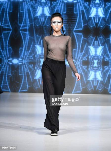 A model walks the runway wearing Phased by LJ at 2018 Vancouver Fashion Week Day 3 on March 21 2018 in Vancouver Canada