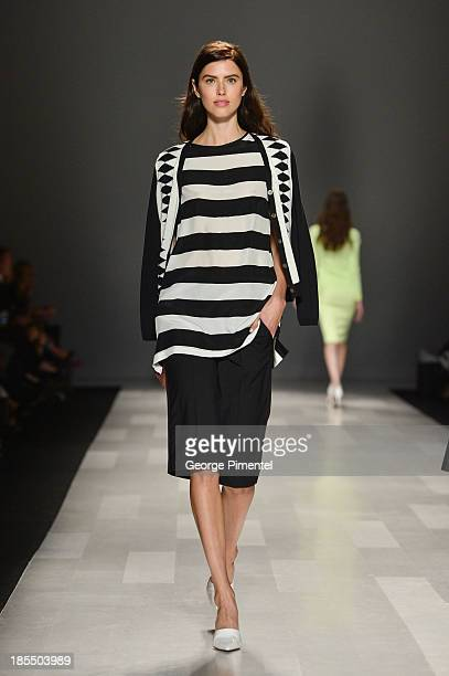 A model walks the runway wearing Pink Tartan spring 2014 collection during World MasterCard Fashion Week Spring 2014 at David Pecaut Square on...