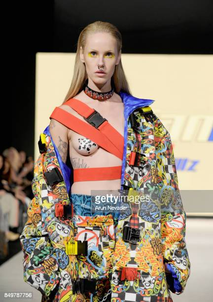 A model walks the runway wearing Profanity by LillsKillz at the 2017 Vancouver Fashion Week Day 2 on September 19 2017 in Vancouver Canada