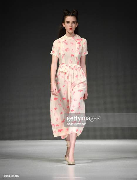 A model walks the runway wearing PYT at 2018 Vancouver Fashion Week Day 4 on March 22 2018 in Vancouver Canada