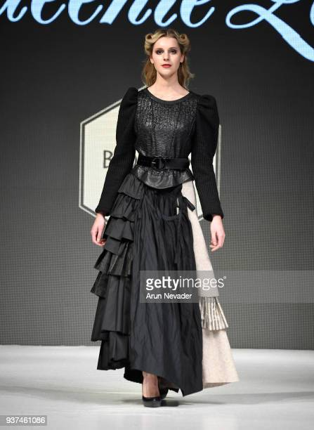 Model walks the runway wearing Queenie Zoe by Bomin Kim at 2018 Vancouver Fashion Week - Day 4 on March 22, 2018 in Vancouver, Canada.