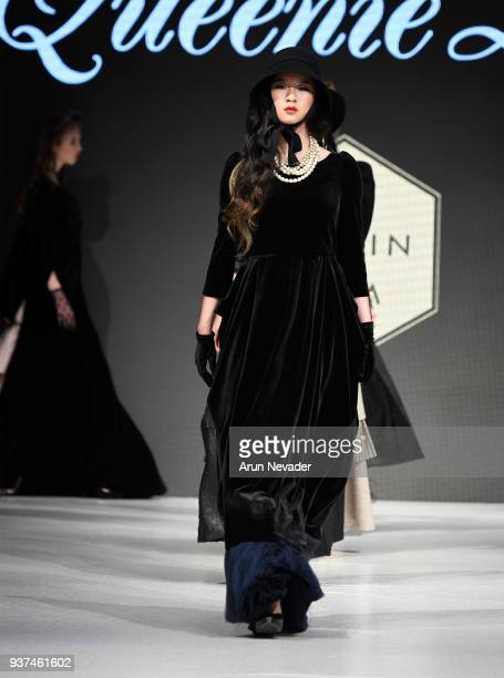 A model walks the runway wearing Queenie Zoe by Bomin Kim at 2018 Vancouver Fashion Week Day 4 on March 22 2018 in Vancouver Canada