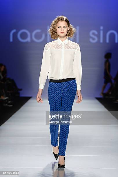 A model walks the runway wearing Rachel Sin spring 2015 collection during World MasterCard Fashion Week Spring 2015 at David Pecaut Square on October...