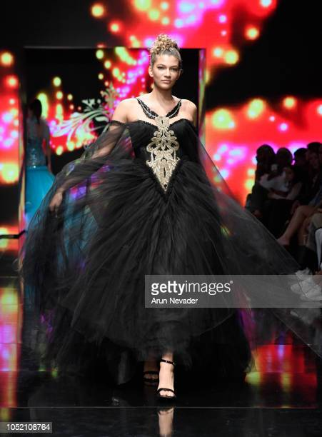 A model walks the runway wearing RC Caylan at Los Angeles Fashion Week Powered by Art Hearts Fashion LAFW SS/19 at The Majestic Downtown on October...