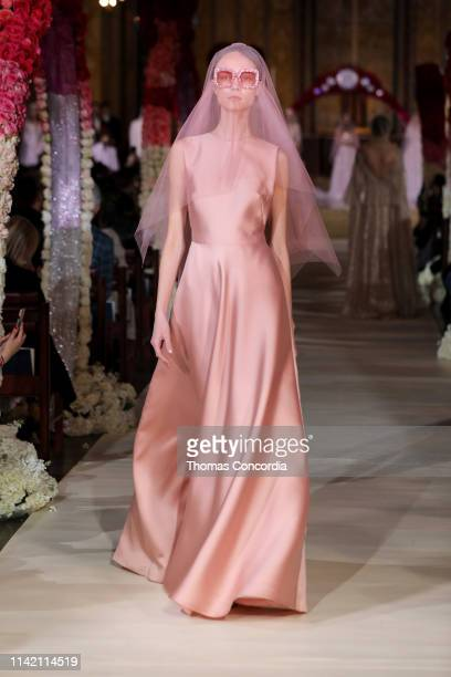 A model walks the runway wearing Reem Acra Bridal on April 11 2019 in New York City