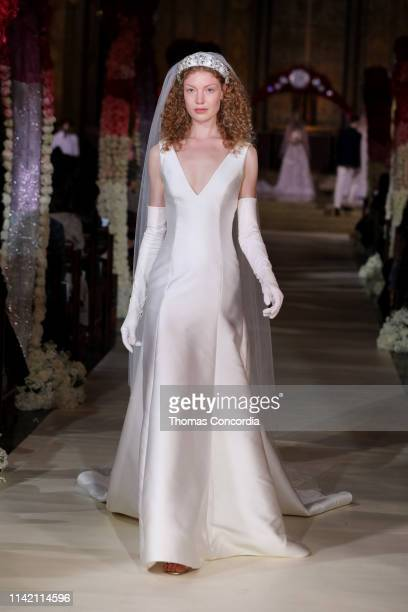 Model walks the runway wearing Reem Acra Bridal on April 11, 2019 in New York City.