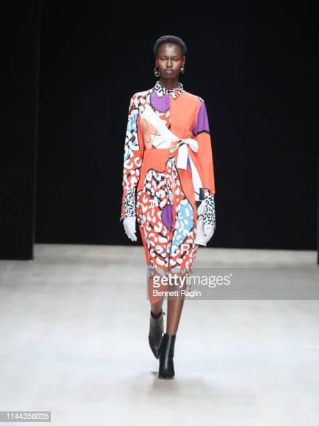 Model walks the runway wearing Rich Minsi during Arise Fashion Week on April 21, 2019 in Lagos, Nigeria.