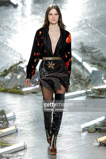 A model walks the runway wearing Rodarte Fall 2015 during MercedesBenz Fashion Week at Center 548 on February 17 2015 in New York City