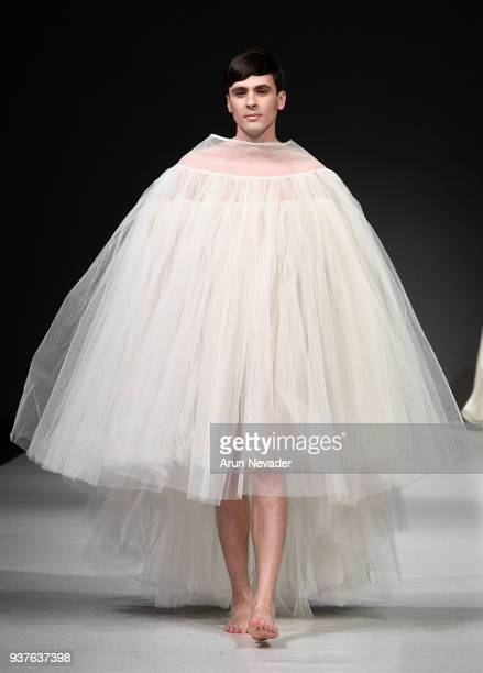 A model walks the runway wearing Romina Dorigo 2018 Vancouver Fashion Week Day 5 at on March 23 2018 in Vancouver Canada