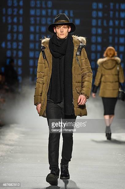 A model walks the runway wearing Rudsak fall 2015 collection during World MasterCard Fashion Week Fall 2015 at David Pecaut Square on March 26 2015...