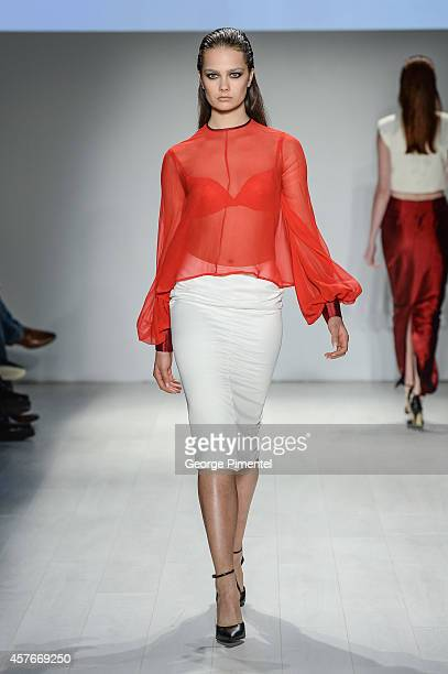 A model walks the runway wearing RudyBois spring 2015 collection during World MasterCard Fashion Week Spring 2015 at David Pecaut Square on October...