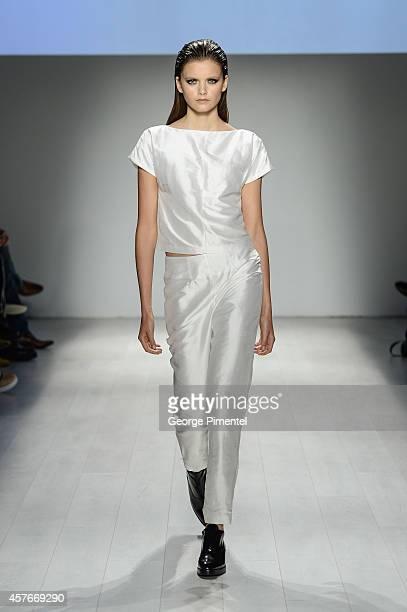 Model walks the runway wearing RudyBois spring 2015 collection during World MasterCard Fashion Week Spring 2015 at David Pecaut Square on October 22,...