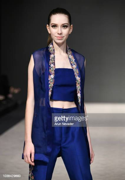 A model walks the runway wearing Shamsha Hashwani at Vancouver Fashion Week Spring/Summer 19 Day 6on September 22 2018 in Vancouver Canada