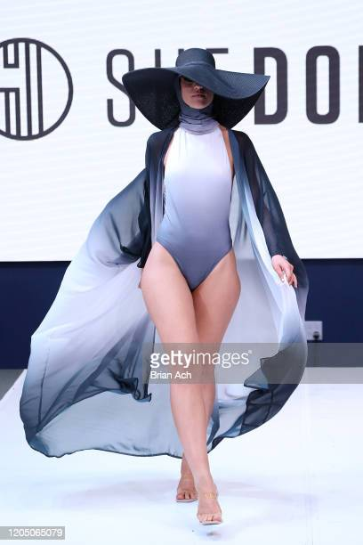 Model walks the runway wearing She Does Official during NYFW Powered By hiTechMODA on February 08, 2020 in New York City.