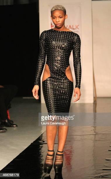 Model walks the runway wearing Siana Treece design at the Hairshion fashion show during MercedesBenz Fashion Week Fall 2014 at Alvin Alley Studios on...