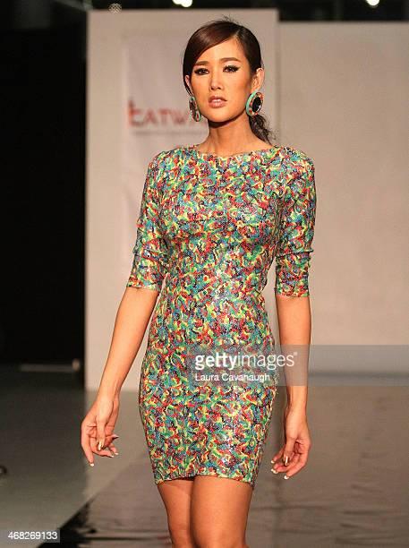 Model walks the runway wearing Siana Treece design at the Hairshion fashion show during MercedesBenz Fashion Week Fall 2014 at Alvin Alley Studios on...