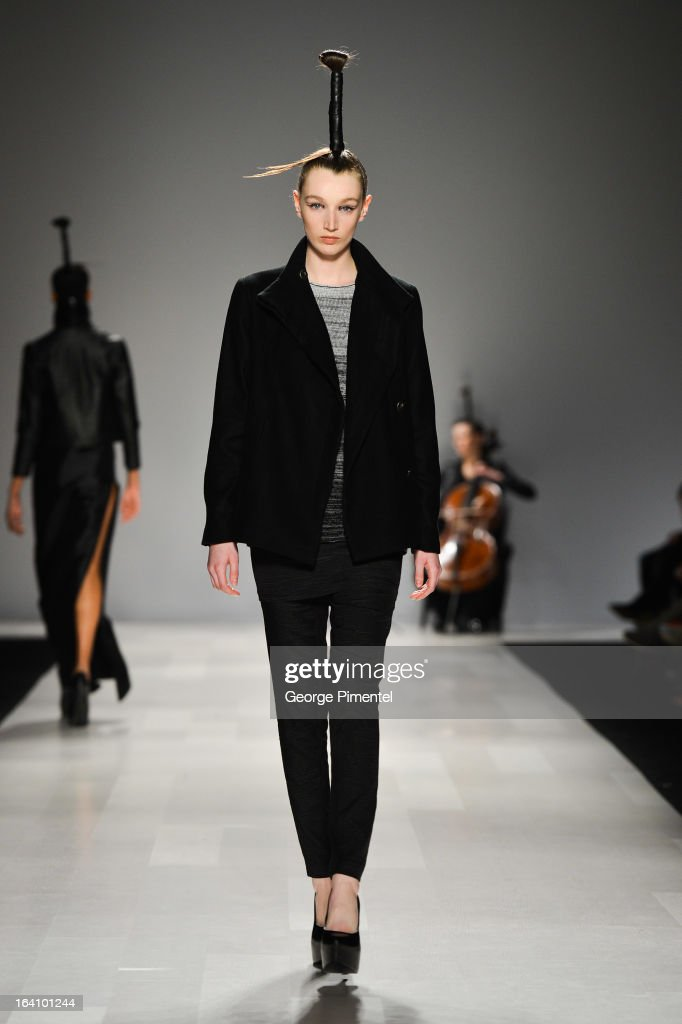A model walks the runway wearing Sid Neigum fall 2013 collection during World MasterCard Fashion Week Fall 2013 at David Pecaut Square on March 19, 2013 in Toronto, Canada.