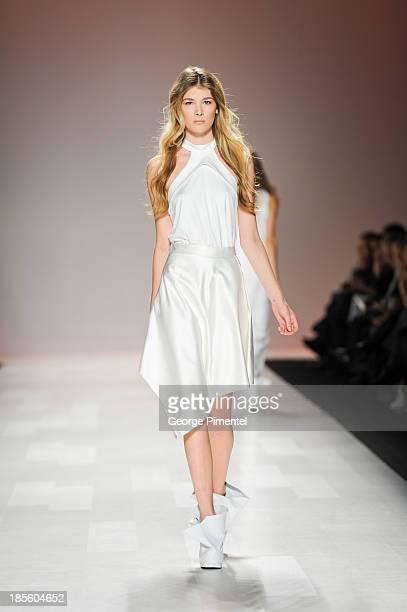 A model walks the runway wearing Sid Neigum spring 2014 collection during World MasterCard Fashion Week Spring 2014 at David Pecaut Square at David...