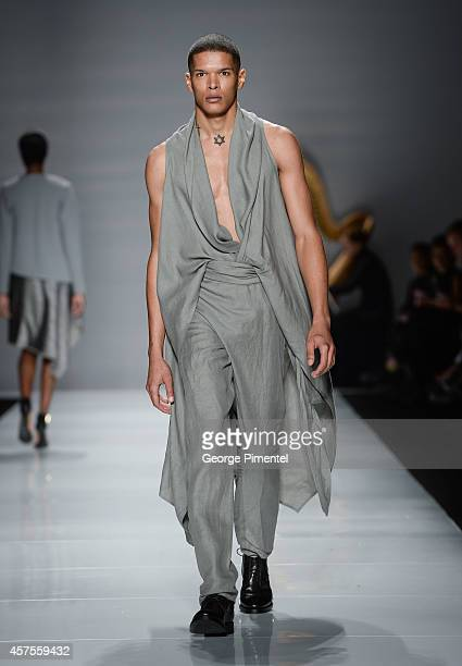 A model walks the runway wearing Sid Neigum spring 2015 collection during World MasterCard Fashion Week Spring 2015 at David Pecaut Square on October...