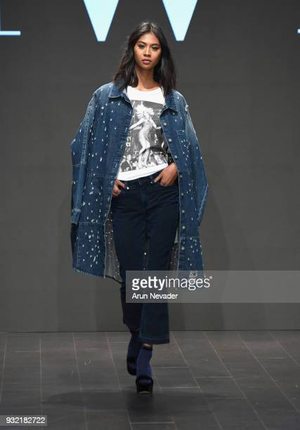 A model walks the runway wearing Siwy Denim at Los Angeles Fashion Week Powered by Art Hearts Fashion LAFW FW/18 10th Season Anniversary at The...