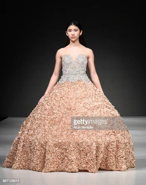 A model walks the runway wearing Slayedbyten at 2018 Vancouver Fashion Week Day 3 on March 21 2018 in Vancouver Canada