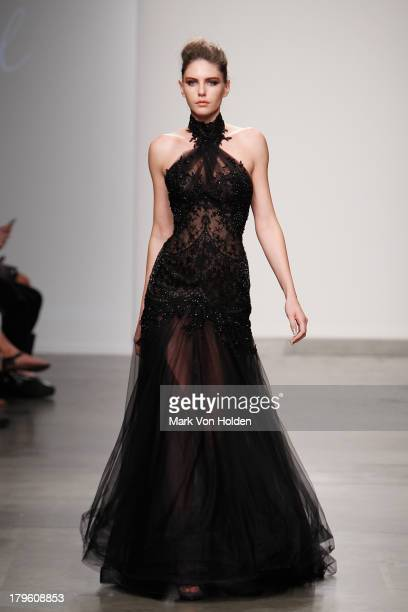 A model walks the runway wearing Steven Khalil in the Fashion Palette Australia fashion show during MercedesBenz Fashion Week Spring 2014 at Pier 59...