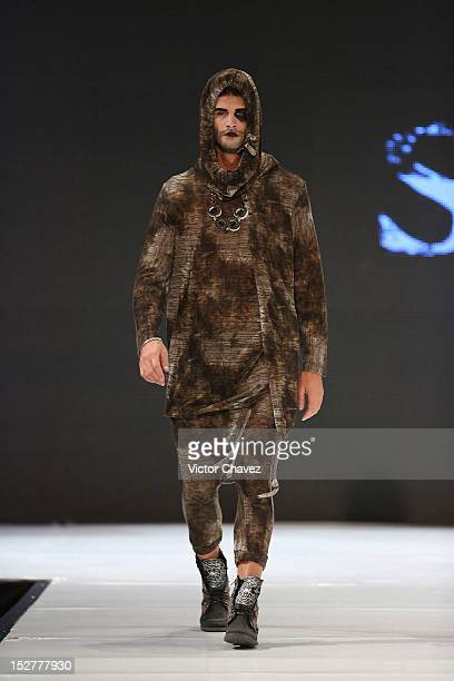 A model walks the runway wearing Stres during the first day of Google Fashion Mexico at Estudios Churubusco on September 25 2012 in Mexico City Mexico