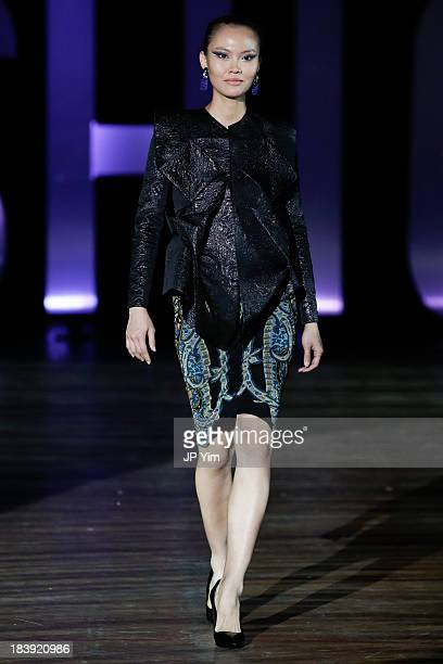 A model walks the runway wearing Sukeina during the 3rd Annual United Colors Of Fashion Gala at Lexington Avenue Armory on October 9 2013 in New York...