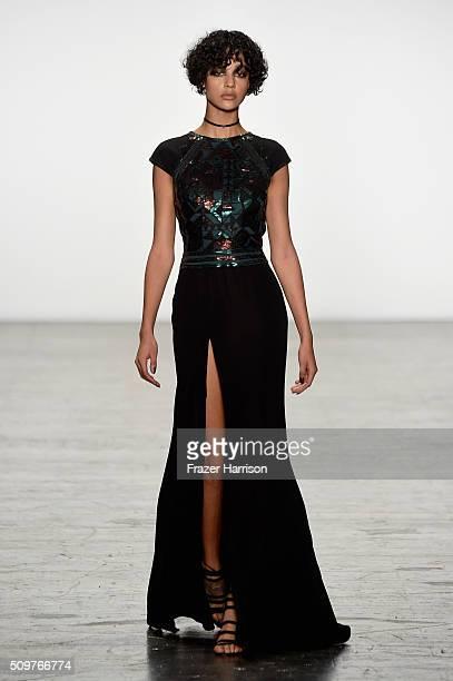 A model walks the runway wearing Tadashi Shoji Fall 2016 during New York Fashion Week The Shows at The Arc Skylight at Moynihan Station on February...